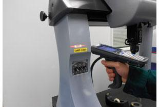 An employee of Arundel Machine Tool scanning a gage