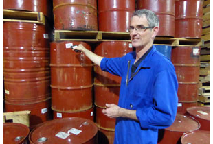 An employee of Cammell's scanning barrels of Honey